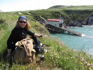 Catherine overlooking the lifeboat station and funicular at St Justinian's Bay, on the Pembrokeshire Coast Path