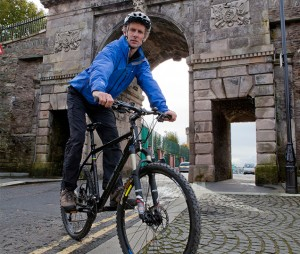 Lawrence McBride, founder Far and Wild on Derry-Londonderry's city walls Photo credit: Far and Wild